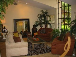 Formal Living Room with high ceilings and Palladium window