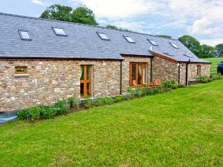YSGUBOR HIR, stone cottage, surrounded by open fields, lawned garden, off road parking, in Llanedi, Ref 16482