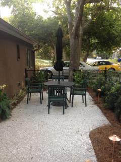 Patio with umbrella table and 4 chairs