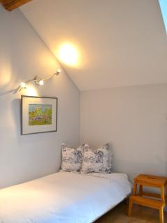 One of two twin beds in Loft Master Bedroom
