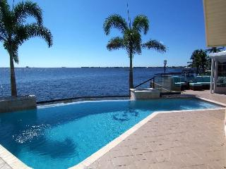 The River View - SE Cape Coral Riverfront, Luxury Pool Home, Contemporary Furnished, Sony Playstation 3, Pool Table and much more......