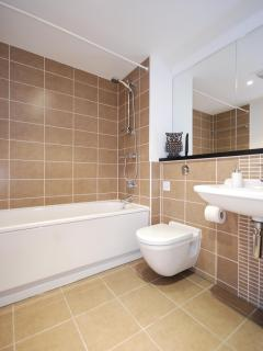 Bathroom with hower over bath