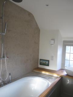 Bathroom with full tub and shower