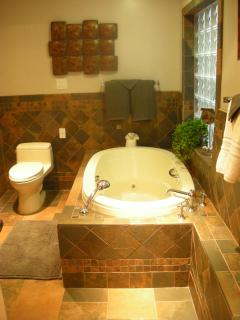 Full custom tiled bath with Jacuzzi, Toto toilet  and all Hansgrohe fixtures
