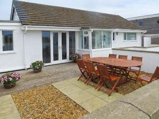 ST WINIFREDS, detached coastal single-storey cottage, pet-friendly, external garden room, parking, enclosed patio, in Rhosneigr Ref 20100