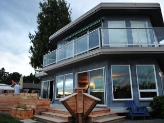 Views on both levels and a huge wrap-around deck for entertaining