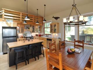 Kitchen and dining. Note that loft is decorative only.