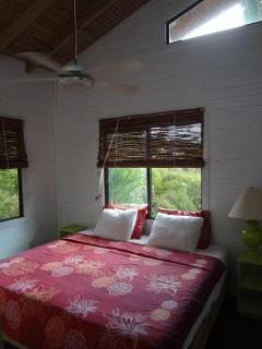 The Tree Top Cottage bedrooms feature 1 king bed or 2 single bed configurations
