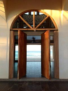 large wood swing front door entry