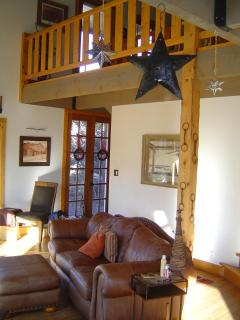 Another view of the spacious living room, front door & upstairs loft. Getting comfortable is easy!