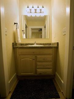 Lavatory is located outside the bathroom for convenient access