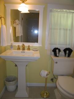 Bathroom with tub/shower.  Plush robes are provided for your enjoyment.