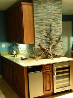 Long wet bar, ice machine, wine cooler, ice-crushing blender, sink and all bar gadgets!