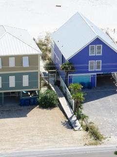 Gated/private beach access across street, to left of periwinkle blue house