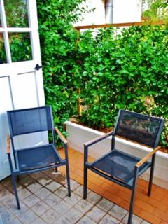 private garden area with table and chairs