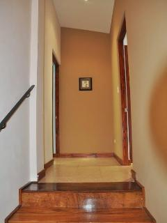 Hallway leading to upstairs bedrooms