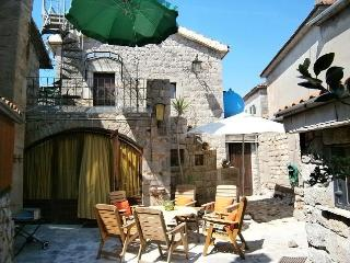 Old stonehouse in middle of small village, Krasici