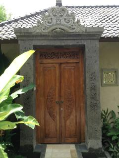 The hand carved stone/wooden entrance to Villa Laba Puseh