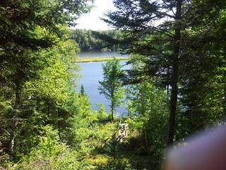 view of lake and loon island from deck