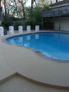 Pool and guest parking area.