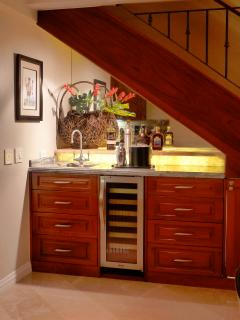 Wet bar with wine coler and sink.