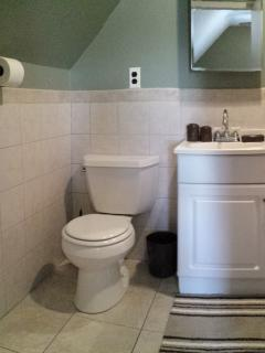 View of the bathroom with shower and tub on the right