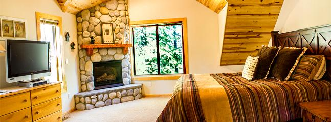 Master Suite with gas fireplace, vaulted ceilings and great views.