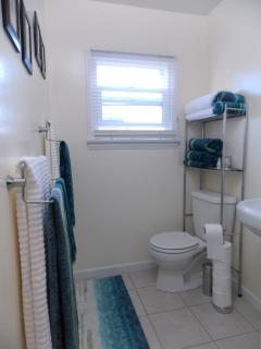 Well equipped bathroom with shower
