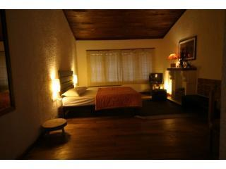 greenspaces homestay wooden floored bedroom