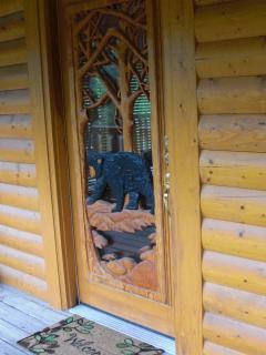 Please come in. Our custom bear-carved door has keyless entry.