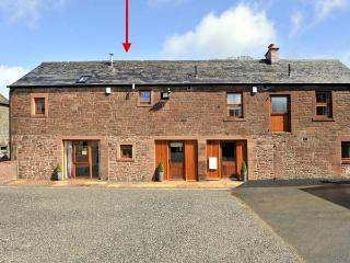 THE OLD GRAINSTORE, family accommodation, character features, woodburner, en-suite bedroom, near Wigton, Ref 18931
