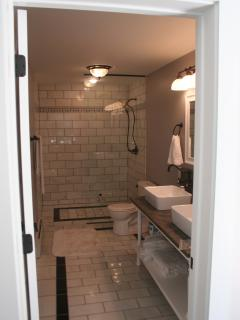 Deluxe Master bath with huge shower and heated marble floors
