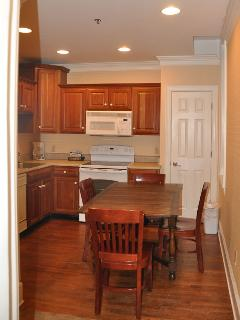Dining area included in stocked kitchen.