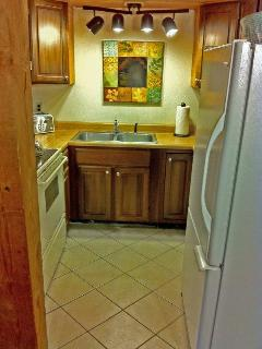 Right Unit: Fully stocked and equipped kitchen