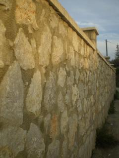 The wall that surrounds the Villa Panagos Studios and Apartment
