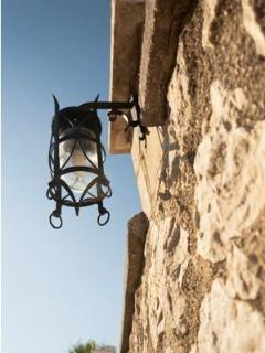 Tailormade lamp, detail from the wall that surrounds Villa Panagos