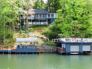 Vintage cabin on Lake Lure with outdoor fire pit.