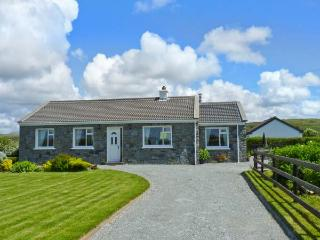 COURHOOR LAKE COTTAGE, open fire and solid-fuel stove, all ground floor, off road parking, in Claddaghduff near Clifden, Ref. 25871