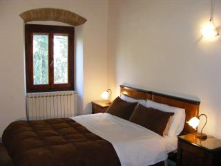 The romantic bedroom with view into the garden and the Ambra Valley - First Floor