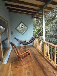 Extra wide balcony is perfect for hanging out in the hammock and snoozing with the sloths!