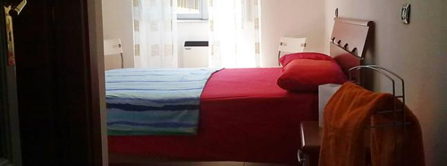the double bed in the room from the entrance