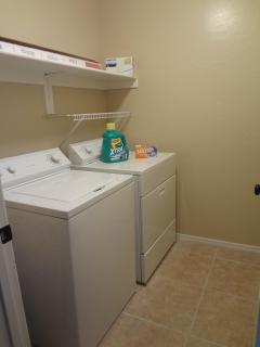 Laundry room. Stocked with detergent, dryer sheets, iron, etc.