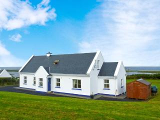 CROSS WINDS, detached cottage, open fire, enclosed gardens, sea views, near Louisburgh, Ref 27351