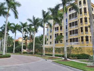 Step into this beautifully decorated third floor condo in one of Naples most prestigious communities