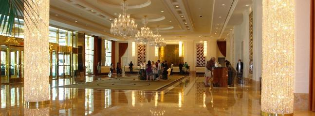 An expansive lobby of imported marble and crystal greets visitors upon arrival.