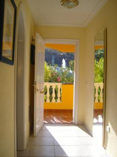 Morning sunshine pours into your front hall - fountain just glimpsed through the verdant foliage!