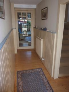 Bright hallway with views to drinks room and rear courtyard