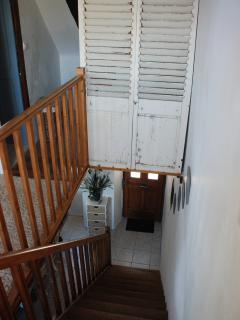 Leading up the wooden staircase to the top level, you'll find the large main bedroom and bathro
