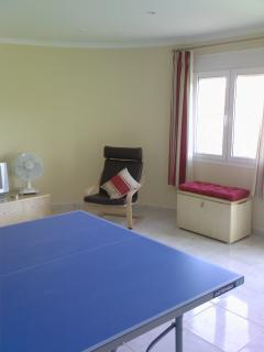Lounge area in Apartment Jacquita with folding table tennis table