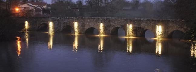 The 11th Century Roman Bridge is one of the views, down by the private river frontage